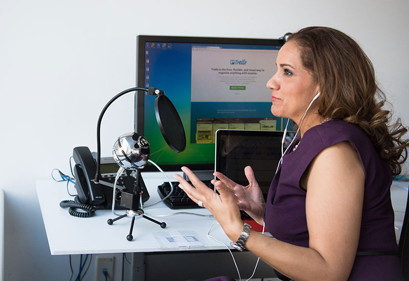 Teacher preparing lesson with microphone and sound equipment
